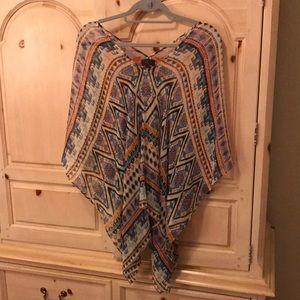 Poncho style silk top